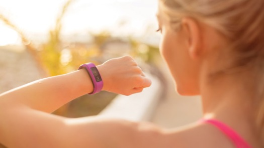 Woman looking at wearable fitness device