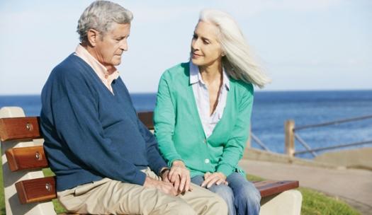 18732519 - senior woman comforting depressed husband sitting on bench