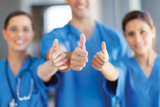 15692947 - group of healthcare workers thumbs up