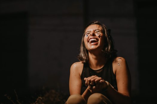 photo-of-a-woman-laughing-wearing-black-top-2219118