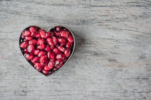 silver-heart-bowl-filled-of-red-pomegranate-seeds-992816