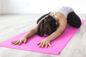 woman-doing-yoga-pose-on-pink-yoga-mat-374589