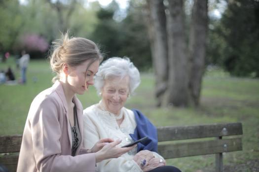 daughter-explaining-elderly-mother-how-using-smartphone-3791666